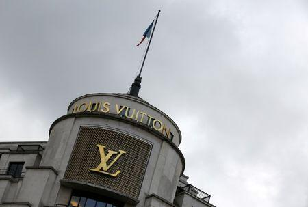 FILE PHOTO: The logo of French luxury group Louis Vuitton is seen at a store in Paris