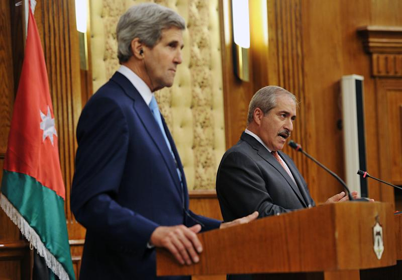 Jordan's Foreign Minister Nasser Judeh speaks during a joint press conference with U.S. Secretary of State John Kerry on Wednesday, July 17, 2013 at the Ministry of Foreign Affairs in the Jordanian capital, Amman. U.S. Secretary of State John Kerry on Wednesday won Arab League backing for his effort to restart Israeli-Palestinian peace talks, raising hopes for a quick resumption in the stalled negotiations. (AP Photo/Mandel Ngan, Pool)