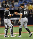 Chicago White Sox catcher Welington Castillo, left, congratulates reliever Jose Ruiz (66) after a win over the Tampa Bay Rays in a baseball game Friday, July 19, 2019, in St. Petersburg, Fla. (AP Photo/Steve Nesius)