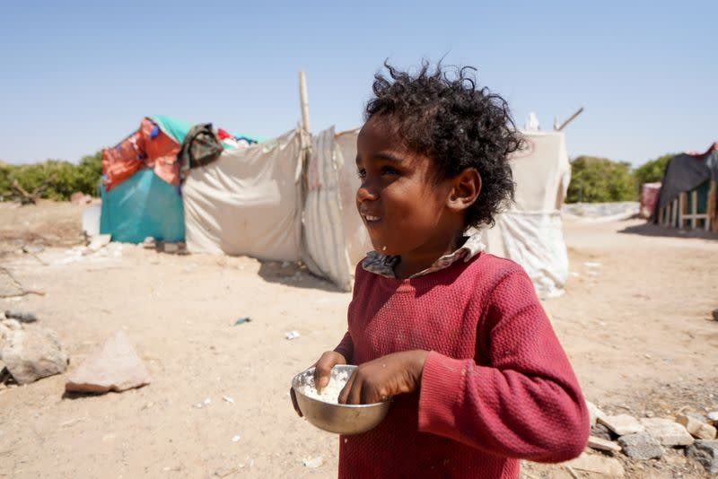 Girl is pictured at a camp for internally displaced people in Marib, Yemen