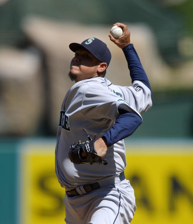 Seattle Mariners starting pitcher Felix Hernandez throws to the plate during the first inning of a baseball game against the Los Angeles Angels, Sunday, Sept. 22, 2013, in Anaheim, Calif. (AP Photo/Mark J. Terrill)