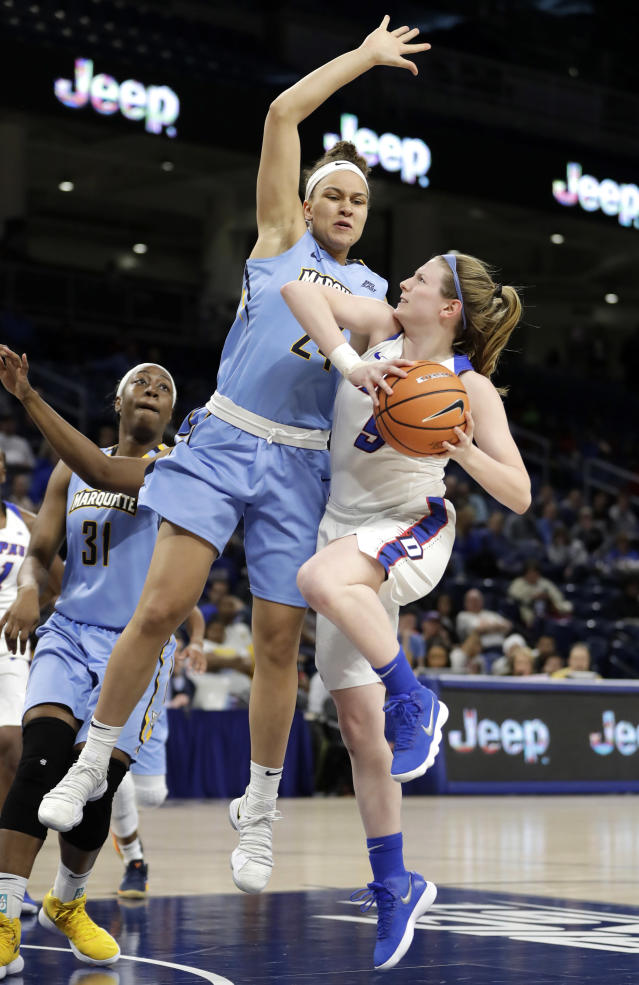 DePaul's Lauren Prochaska (5) drives on Marquette's Selena Lott (24) during the first half of an NCAA college basketball game in the championship of the Big East conference tournament, Tuesday, March 6, 2018, in Chicago. (AP Photo/Charles Rex Arbogast)