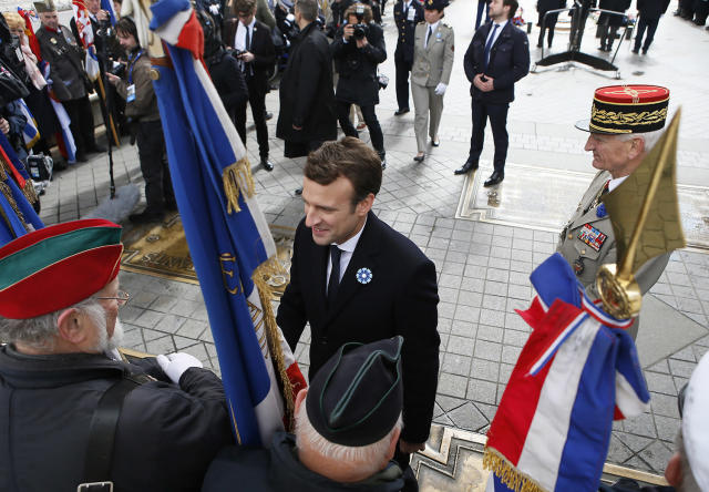 <p>French president-elect Emmanuel Macron, center, greets veterans during a ceremony to mark Victory Day in Paris, France, Monday, May 8, 2017. French president-elect Emmanuel Macron, will appear Monday alongside current President Francois Hollande in commemoration of the end of World War II. Monday, a national holiday, marks the day of the formal German defeat in World War II. (Francois Mori, Pool via AP) </p>