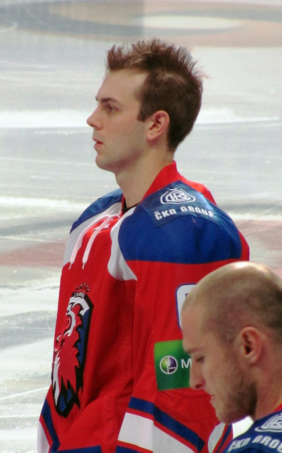 Erik Christensen stands at attention during the anthems before a KHL game. (#NickInEurope)