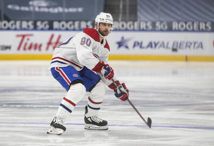 Montreal Canadiens' Tomas Tatar (90) plays against the Edmonton Oilers during first-period NHL hockey game action in Edmonton, Alberta, Saturday, Jan. 16, 2021. (Jason Franson/The Canadian Press via AP)