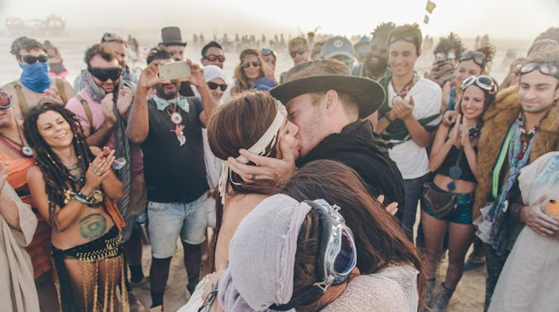 """This wedding was like a dream and definitely made me cry. Some of these people you see in these photos were their friends but many were random onlookers at Burning Man. The emotion and connection was unreal. Magical. You can feel the love in the photos."" -- <i>Steph Grant</i>"