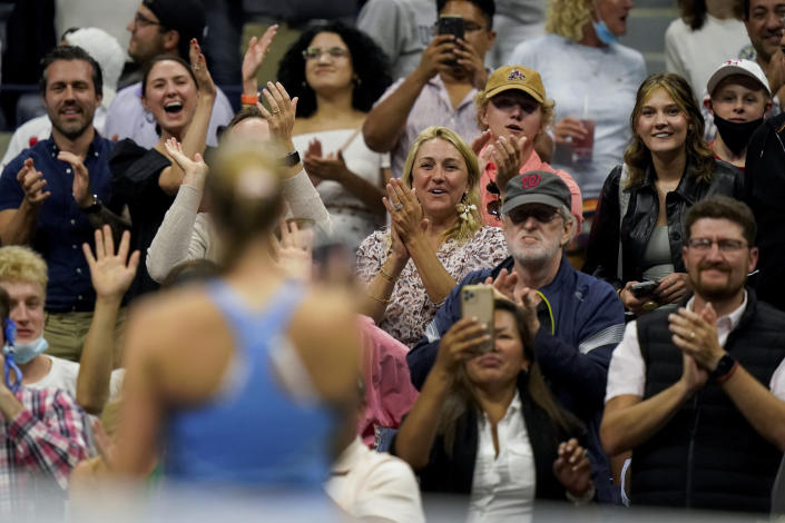 Tennis fans cheer Shelby Rogers, of the United States, after she defeated Ashleigh Barty, of Australia, during the third round of the US Open tennis championships, Saturday, Sept. 4, 2021, in New York. (AP Photo/Frank Franklin II)