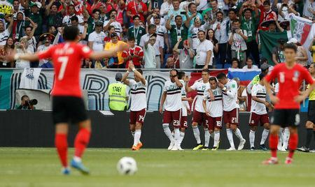 Soccer Football - World Cup - Group F - South Korea vs Mexico - Rostov Arena, Rostov-on-Don, Russia - June 23, 2018 Mexico's Andres Guardado and team mates celebrate their first goal scored by Carlos Vela REUTERS/Damir Sagolj