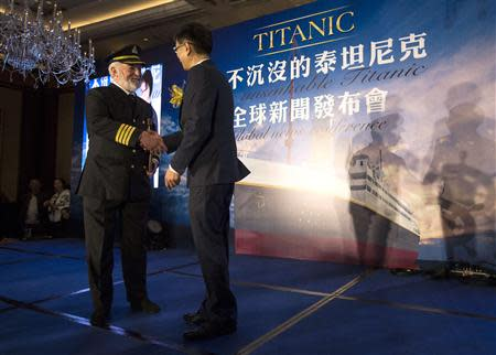 Bernard Hill (L), actor of captain Edward Smith in the 1997 Titanic movie, shakes hands with Su Shaojun, CEO of Seven-Star Energy Investment Group (SSEG), during a news conference in Hong Kong January 12, 2014. REUTERS/Tyrone Siu