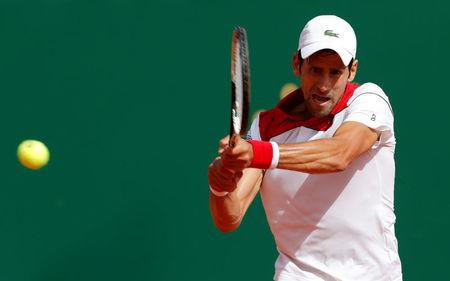 Tennis - ATP - Monte Carlo Masters - Monte-Carlo Country Club, Monte Carlo, Monaco - April 16, 2018   Serbia's Novak Djokovic in action against Serbia's Dusan Lajovic during the first round   REUTERS/Eric Gaillard