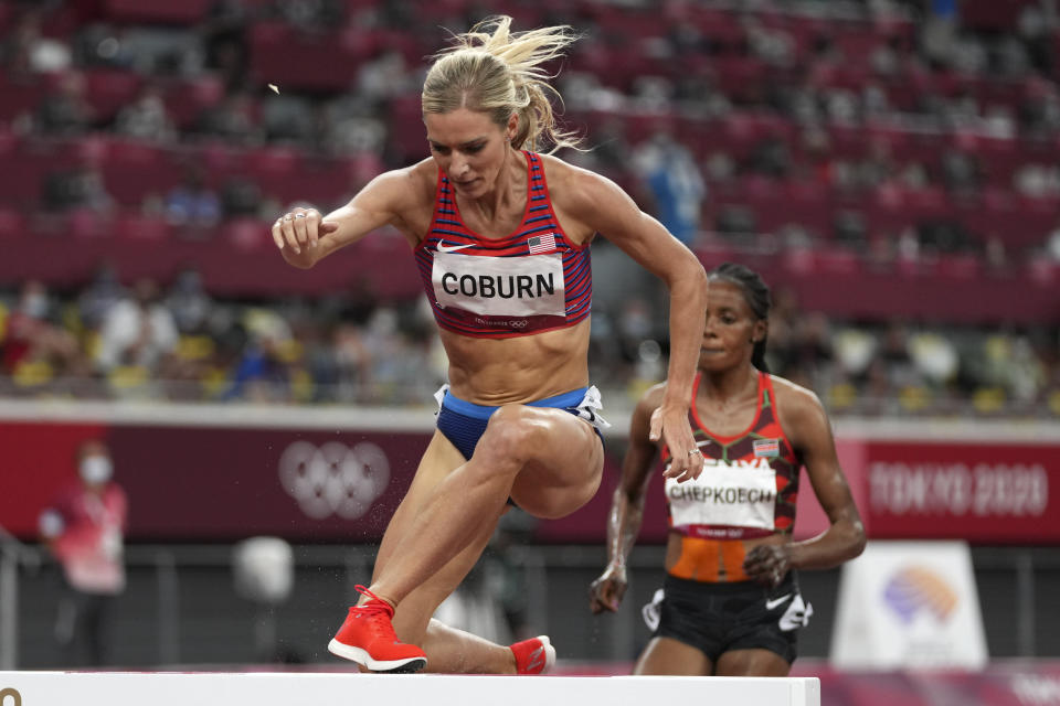 Emma Coburn, of the United States, competes in the final of the women's 3,000-meters steeplechase at the 2020 Summer Olympics, Wednesday, Aug. 4, 2021, in Tokyo. (AP Photo/Matthias Schrader)