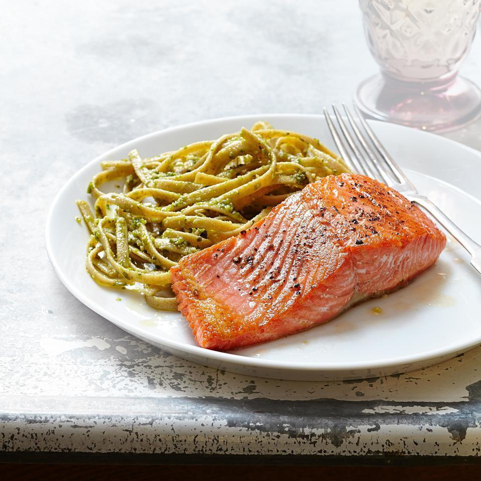 <p>The brightness of basil pesto is a nice match for the buttery flavor of salmon in this quick and healthy dinner recipe. Refrigerated pesto, found near fresh sauces and salsas at most stores, is prettier and has a better taste than jarred varieties.</p>