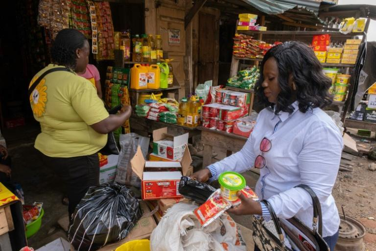 Edith Obatuga, a 43-year-old mother who makes $120 a month, can no longer afford beans and cut portions of rice due to soaring prices.