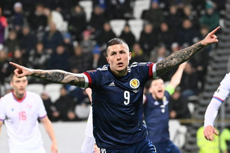 Lyndon Dykes kept alive Scotland's hopes of reaching a first World Cup finals since 1998 (AFP/Jonathan NACKSTRAND)