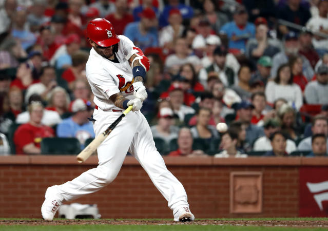 St. Louis Cardinals' Yadier Molina hits a two-run home run during the sixth inning of the team's baseball game against the Los Angeles Dodgers on Wednesday, April 10, 2019, in St. Louis. (AP Photo/Jeff Roberson)
