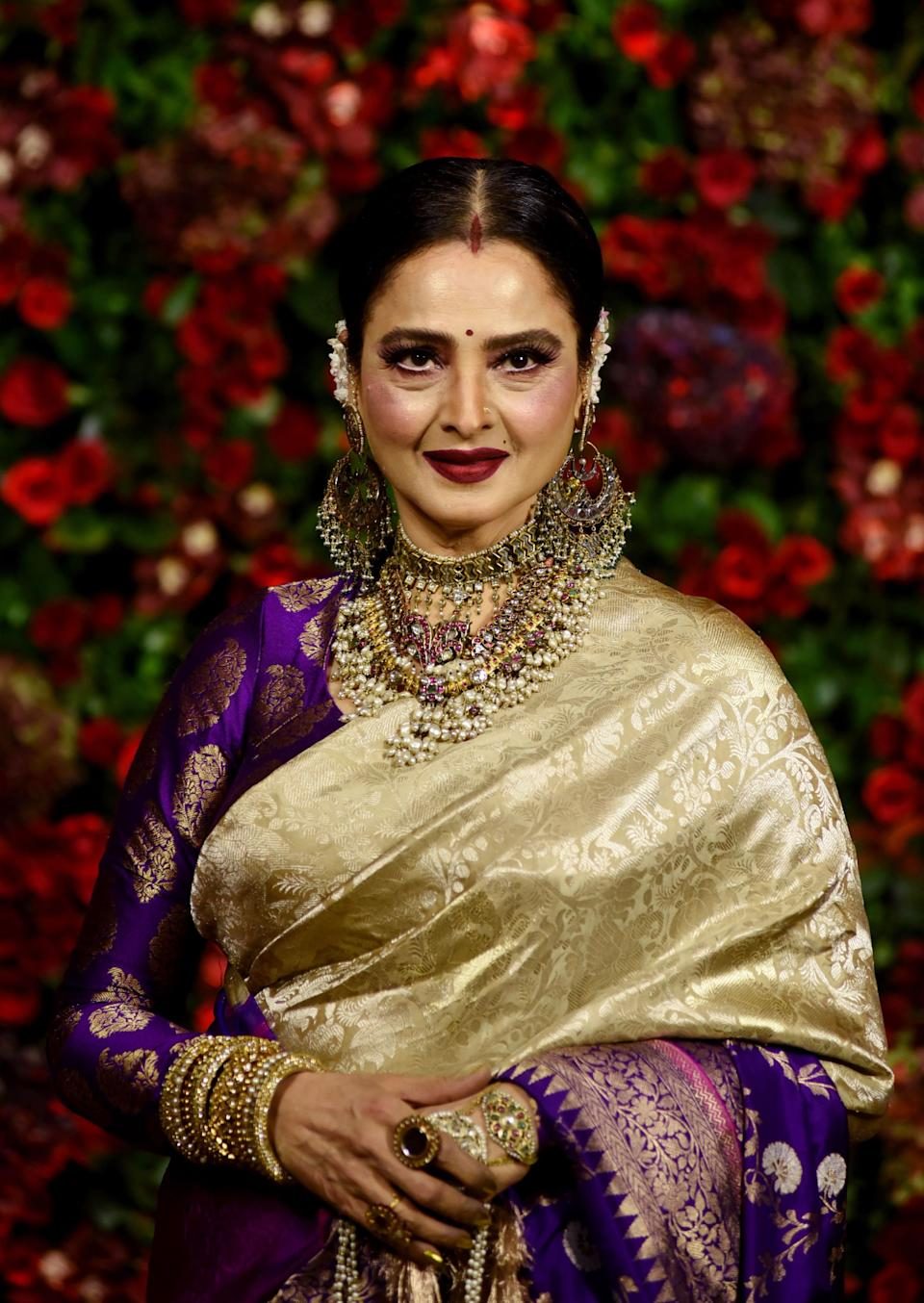 Indian Bollywood actress Rekha poses for a picture during the wedding reception party of actors Ranveer Singh and Deepika Padukone in Mumbai late on December 1, 2018. (Photo by Sujit Jaiswal / AFP) (Photo by SUJIT JAISWAL/AFP via Getty Images)