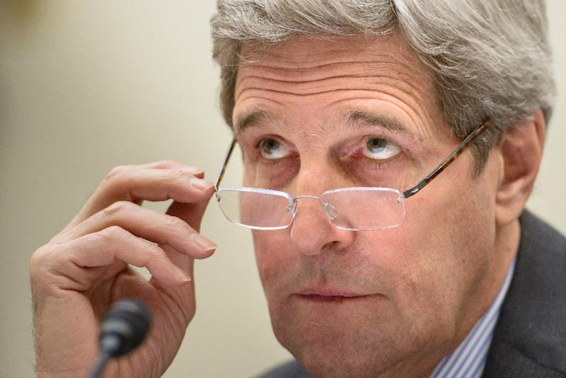 US Secretary of State John Kerry listens during a hearing of the House Foreign Affairs Committee on Capitol Hill on February 25, 2015, in Washington, DC