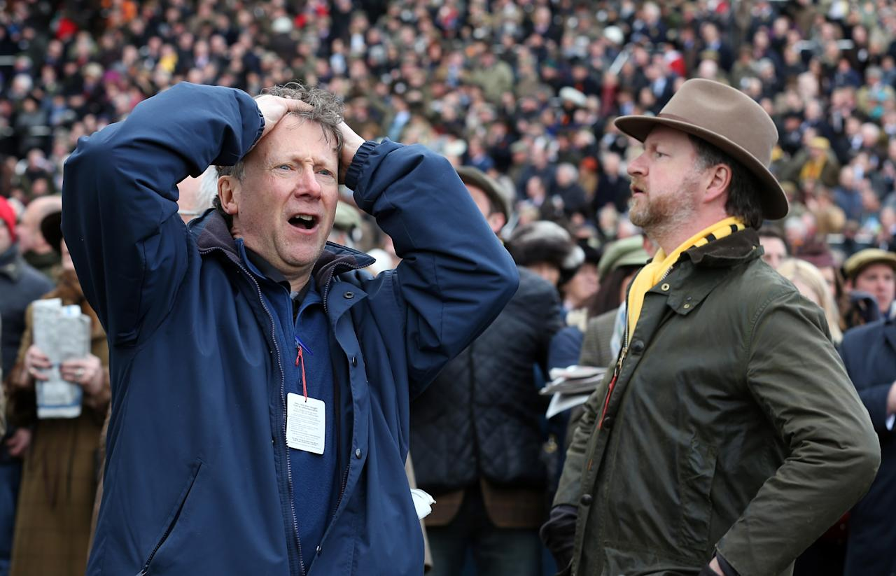 CHELTENHAM, ENGLAND - MARCH 13:  A racegoer reacts following the first race on Ladies Day at Cheltenham Racecourse on the second day of the Cheltenham Festival 2013 on March 13, 2013 in Cheltenham, England. Approximately 200,000 racing enthusiasts are expected at the four-day festival, which opened today and is seen by many as the highlight of the jump racing calendar.  (Photo by Matt Cardy/Getty Images)