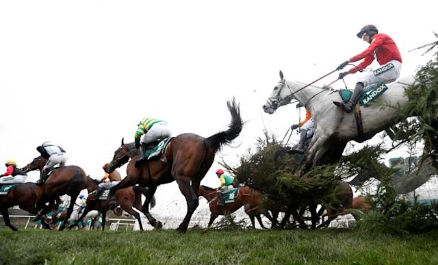 Horse Racing - Grand National Festival - Aintree Racecourse, Liverpool, Britain - April 13, 2018 General view as horses clear the fence at Canal Turn during the 16:05 Randox Health Topham Handicap Chase Action Images via Reuters/Matthew Childs