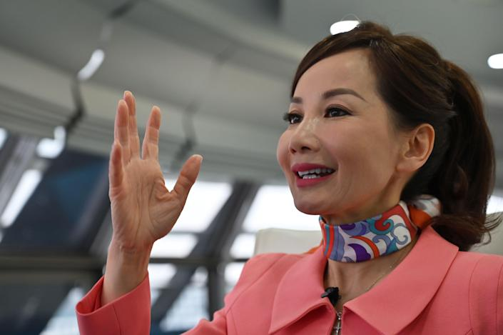 Travel services company CEO of Ctrip Jane Jie Sun Jie speaks during an interview with AFP in the facilities of Ctrip in Shanghai on April 26, 2019. (Photo by HECTOR RETAMAL / AFP) (Photo credit should read HECTOR RETAMAL/AFP/Getty Images)