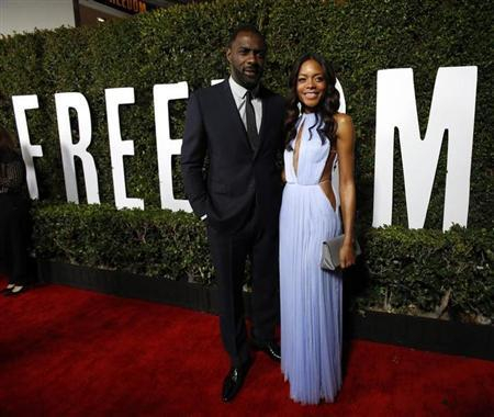 """Elba and Harris pose at the premiere of """"Mandela: Long Walk to Freedom"""" in Los Angeles"""