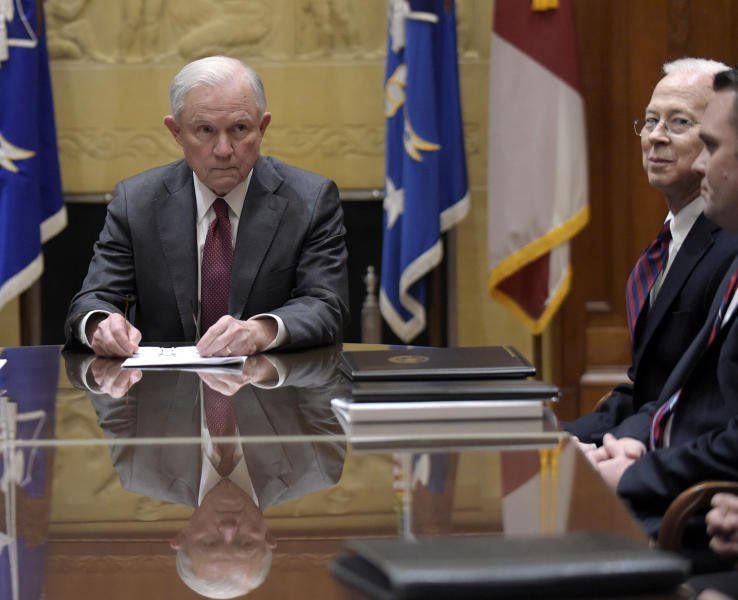FILE - In this Feb. 9, 2017 file photo, Attorney General Jeff Sessions, left, holds a meeting with the heads of federal law enforcement components at the Department of Justice in Washington,. Acting Deputy Attorney General Dana Boente is at right. Boenete, an understated career federal prosecutor, has found himself at the epicenter of several of the Trump administration's biggest controversies. (AP Photo/Susan Walsh, Pool)