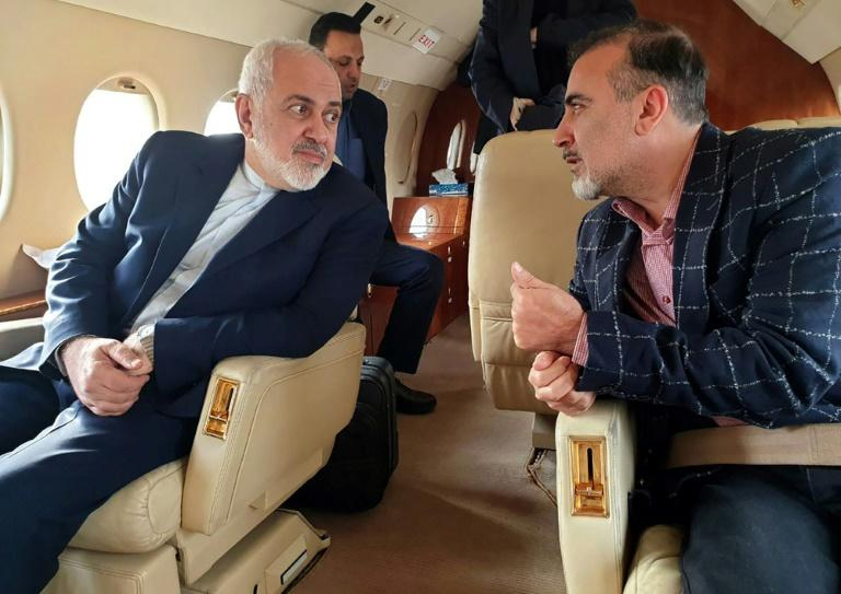 A handout picture released by the Iranian Foreign Minister's official Twitter account on December 7, 2019, shows Foreign Minister Mohammad Javad Zarif (L) and Iranian scientist Massoud Soleimani in a plane following a prisoner exchange with the US