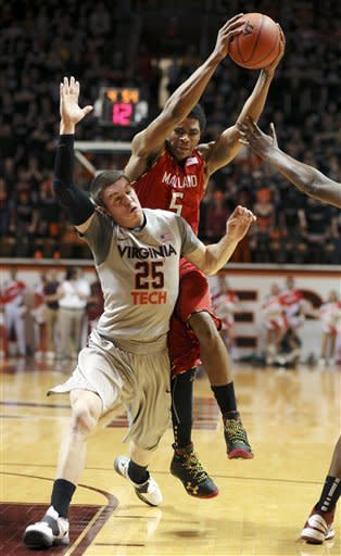 Maryland's Nick Faust (5) collides with Virginia Tech's Will Johnston (25) during the first half of their NCAA college basketball game, Thursday, Feb. 7, 2013, in Blacksburg, Va. (AP Photo/The Roanoke Times, Matt Gentry)