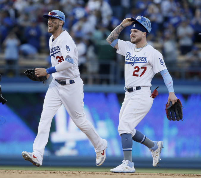 Los Angeles Dodgers center fielder Alex Verdugo, right, celebrates with right fielder Cody Bellinger after catching a fly ball for the last out against the Chicago Cubs at the end of a baseball game in Los Angeles, Sunday, June 16, 2019. The Dodgers won 3-2. (AP Photo/Alex Gallardo)