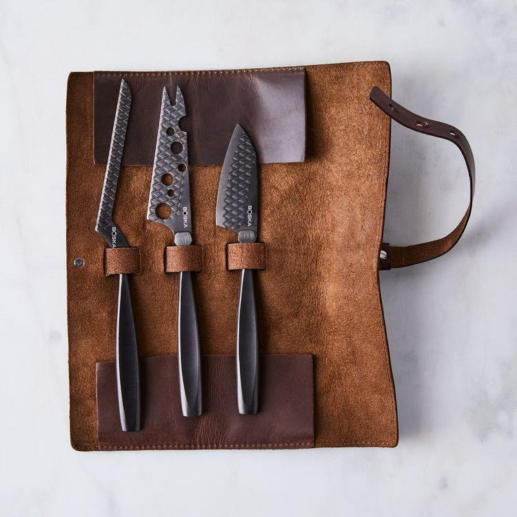 """<h2>Monaco Black Cheese Knife Set With Leather Roll</h2><br>From aged cheddar to brie, there's no cheese these aesthetically-pleasing knives can't cut through. <br><br><strong><em><a href=""""https://food52.com/shop/merchants/boska"""" rel=""""nofollow noopener"""" target=""""_blank"""" data-ylk=""""slk:Shop Food52"""" class=""""link rapid-noclick-resp"""">Shop Food52</a></em></strong><br><br><strong>Monaco</strong> Monaco Black Cheese Knife set with Leather Roll, $, available at <a href=""""https://go.skimresources.com/?id=30283X879131&url=https%3A%2F%2Ffood52.com%2Fshop%2Fproducts%2F5834-monaco-black-cheese-knife-set-with-leather-roll"""" rel=""""nofollow noopener"""" target=""""_blank"""" data-ylk=""""slk:Food52"""" class=""""link rapid-noclick-resp"""">Food52</a>"""