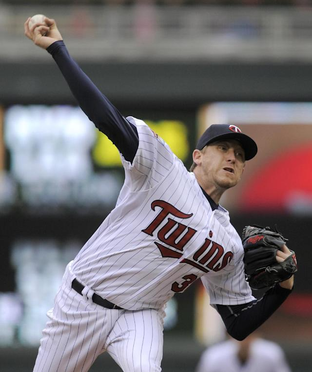Minnesota Twins pitcher Kevin Correia throws against the Kansas City Royals during the first inning of a baseball game in Minneapolis, Sunday, April 13, 2014. (AP Photo/Tom Olmscheid)