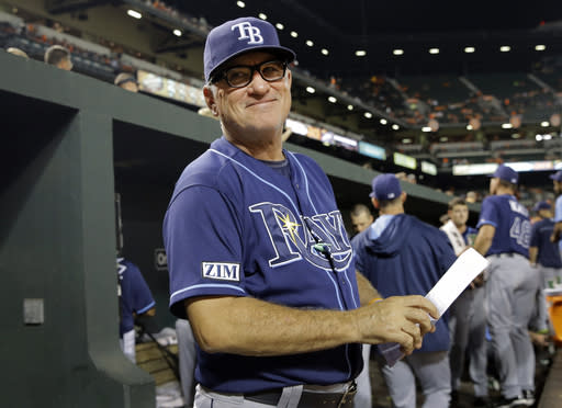 FILE - In this Aug. 27, 2014, file photo, Tampa Bay Rays manager Joe Maddon smiles at a fan in the stands in the fifth inning of a baseball game against the Baltimore Orioles in Baltimore. The Cubs have fired manager rick Renteria after one season to pursue former Tampa Bay manager Joe Maddon. Team President Theo Epstein said Friday, Oct. 31, 2014, that Renteria deserved to come back next season as the Cubs continue their rebuilding effort. But Maddon opted out of his contract with the Rays and Epstein says that changed things for the Cubs. (AP Photo/Patrick Semansky, File)