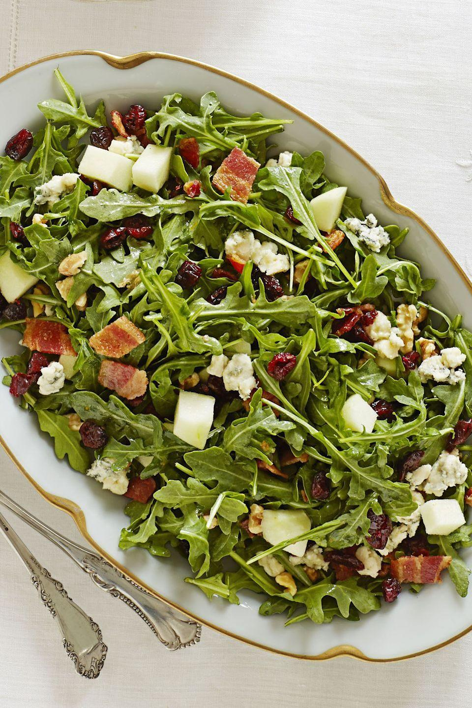 """<p>Bacon and blue cheese give this salad an exciting twist, while the orange dressing, arugula and apples keep it lively and fresh.</p><p><em><a href=""""https://www.goodhousekeeping.com/food-recipes/a11597/cape-cod-chopped-salad-recipe-ghk1113/"""" rel=""""nofollow noopener"""" target=""""_blank"""" data-ylk=""""slk:Get the recipe for Cape Cod Chopped Salad »"""" class=""""link rapid-noclick-resp"""">Get the recipe for Cape Cod Chopped Salad »</a></em> </p>"""