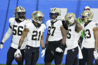New Orleans Saints cornerback Patrick Robinson (21) celebrates with teammates after intercepting a pass in the end zone during the first half of an NFL football game against the Detroit Lions, Sunday, Oct. 4, 2020, in Detroit. (AP Photo/Duane Burleson)