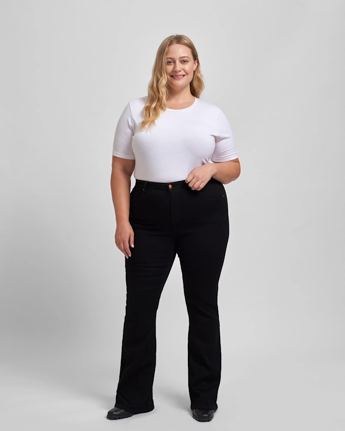 """$80 jeans that just so happen to be perfect <em>and</em> size-inclusive? We'll take two pairs. <br> <br> <strong>Universal Standard</strong> Sava High Rise Flare Jeans, $, available at <a href=""""https://go.skimresources.com/?id=30283X879131&url=https%3A%2F%2Fwww.universalstandard.com%2Fcollections%2Fsample-sale-all%2Fproducts%2Fsava-high-rise-flare-jeans-black"""" rel=""""nofollow noopener"""" target=""""_blank"""" data-ylk=""""slk:Universal Standard"""" class=""""link rapid-noclick-resp"""">Universal Standard</a>"""