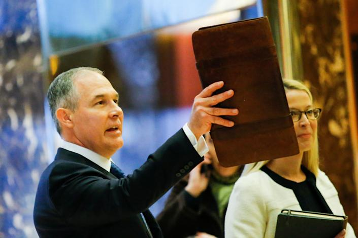 """The EPA&rsquo;s stance on global warming has been unambiguous. <br><br>&ldquo;<a href=""""https://www.epa.gov/climatechange/climate-change-basic-information"""" rel=""""nofollow noopener"""" target=""""_blank"""" data-ylk=""""slk:Climate change is happening"""" class=""""link rapid-noclick-resp"""">Climate change is happening</a>,&rdquo; the agency said&nbsp;on its website, adding that the EPA is &ldquo;taking a number of common-sense steps to address the challenge&rdquo; of warming, such as developing emissions reduction initiatives and contributing to &ldquo;world-class climate research.&rdquo;<br><br>Pruitt, like <a href=""""https://www.theguardian.com/environment/2016/dec/15/trump-cabinet-climate-change-deniers"""" rel=""""nofollow noopener"""" target=""""_blank"""" data-ylk=""""slk:most of Trump&rsquo;s Cabinet picks"""" class=""""link rapid-noclick-resp"""">most of Trump&rsquo;s Cabinet picks</a>, is a climate change denier. Ignoring the overwhelming scientific consensus on the matter, Pruitt wrote last year that the debate on climate change is &ldquo;<a href=""""http://www.nationalreview.com/article/435470/climate-change-attorneys-general"""" rel=""""nofollow noopener"""" target=""""_blank"""" data-ylk=""""slk:far from settled"""" class=""""link rapid-noclick-resp"""">far from settled</a>.&rdquo;&nbsp;<br><br>Gina McCarthy, the previous&nbsp;EPA chief, warned in November that denying the facts about climate change would undermine the United States'&nbsp;success both domestically and internationally. Other countries &ldquo;are wondering if the U.S. will turn its back on science and be left behind,&rdquo; she said.&nbsp;<br><br>&ldquo;The train to a global clean-energy future has already left the station,&rdquo; McCarthy added. &ldquo;We can choose to get on board &mdash; to lead &mdash; or we can choose to be left behind, to stand stubbornly still. If we stubbornly deny the science and change around us, we will fall victim to our own paralysis.&rdquo;"""