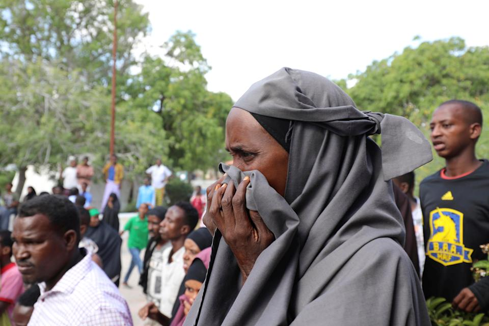 A Somali woman reacts at the scene of a car bomb explosion at a checkpoint in Mogadishu, Somalia  December 28, 2019. REUTERS/Feisal Omar