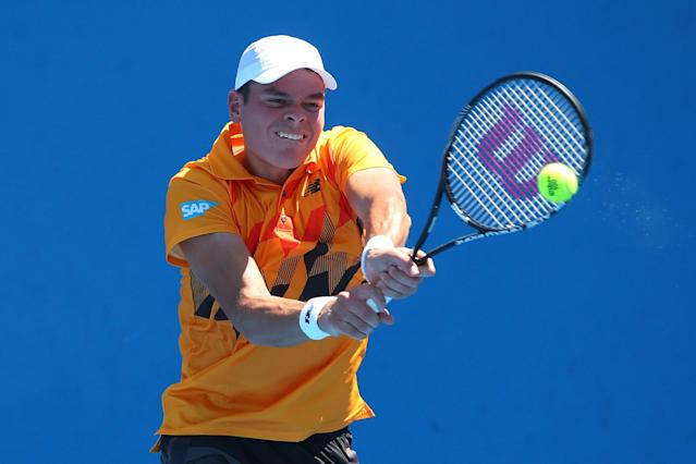 MELBOURNE, AUSTRALIA - JANUARY 14: Milos Raonic of Canada plays a backhand in his first round match against Daniel Gimeno-Traver of Spain during day two of the 2014 Australian Open at Melbourne Park on January 14, 2014 in Melbourne, Australia. (Photo by Chris Hyde/Getty Images)