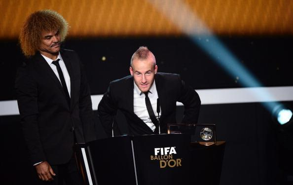 Fenerbahce's Slovakian winger Miroslav Stoch (C) receives the FIFA Puskas award from former Colombian footballer Carlos Valderrama during the FIFA Ballon d'Or awards ceremony at the Kongresshaus in Zurich on January 7, 2013. AFP PHOTO / OLIVIER MORIN (Photo credit should read OLIVIER MORIN/AFP/Getty Images)
