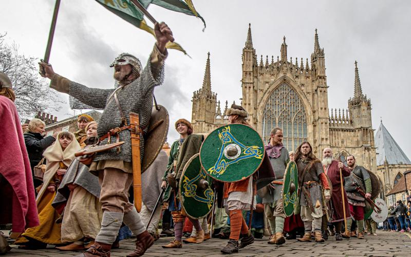 Pictures Shows: Viking from the Jorvik Viking Festival take part in the Viking Parade through York City Centre