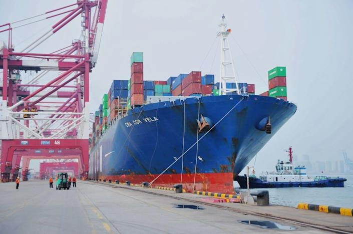 "<span class=""caption"">A moored container ship in Qingdao, China.</span> <span class=""attribution""><a class=""link rapid-noclick-resp"" href=""https://www.gettyimages.com/detail/news-photo/longshoremen-rope-a-recently-moored-freighter-in-qingdao-news-photo/1217233473?adppopup=true"" rel=""nofollow noopener"" target=""_blank"" data-ylk=""slk:Getty Images"">Getty Images</a></span>"