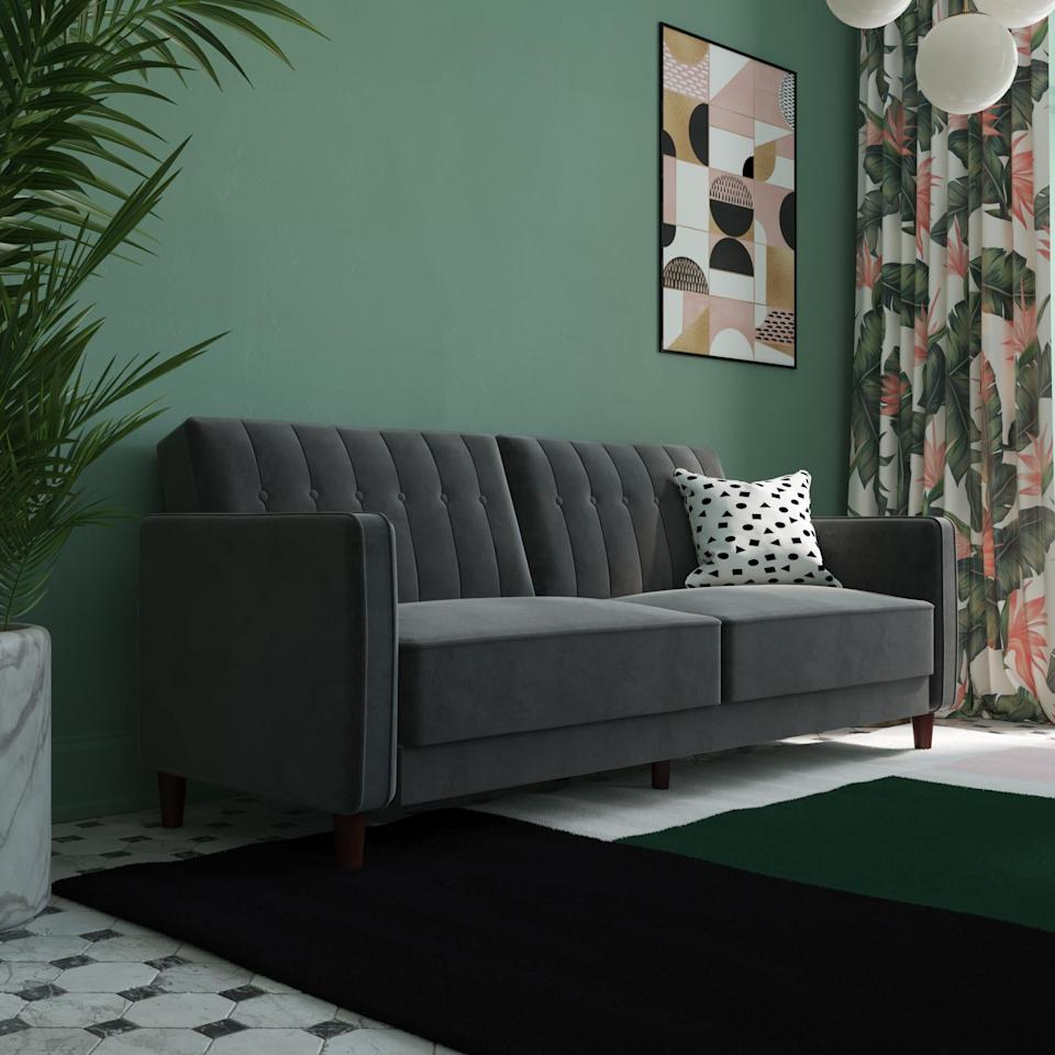 """<p>Simply lay down this <a href=""""https://www.popsugar.com/buy/DHP-Pin-Tufted-Transitional-Velvet-Futon-Couch-415991?p_name=DHP%20Pin%20Tufted%20Transitional%20Velvet%20Futon%20Couch&retailer=walmart.com&pid=415991&price=349&evar1=casa%3Aus&evar9=45894677&evar98=https%3A%2F%2Fwww.popsugar.com%2Fhome%2Fphoto-gallery%2F45894677%2Fimage%2F45894681%2FDHP-Pin-Tufted-Transitional-Velvet-Futon-Couch&list1=home%2Cshopping%2Chome%20decor%2Cfurniture%2Cwalmart%2Csofas%2Cliving%20rooms%2Chome%20shopping&prop13=mobile&pdata=1"""" rel=""""nofollow"""" data-shoppable-link=""""1"""" target=""""_blank"""" class=""""ga-track"""" data-ga-category=""""Related"""" data-ga-label=""""https://www.walmart.com/ip/Simmons-Montreal-Upholstered-Convertible-Sofa-Multiple-Colors/755343639"""" data-ga-action=""""In-Line Links"""">DHP Pin Tufted Transitional Velvet Futon Couch</a> ($349) and it turns into a bed.</p>"""