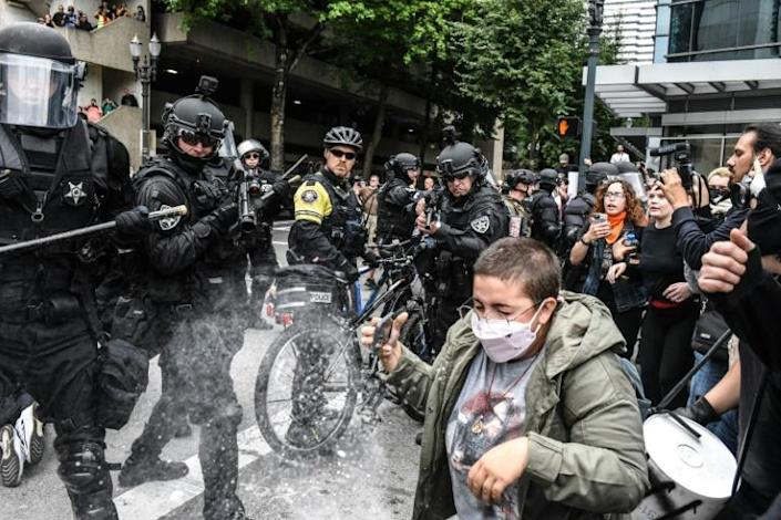 Portland police fire pepper spray into a crowd of counter-protesters on August 17 in Portland, Oregon (AFP Photo/STEPHANIE KEITH)