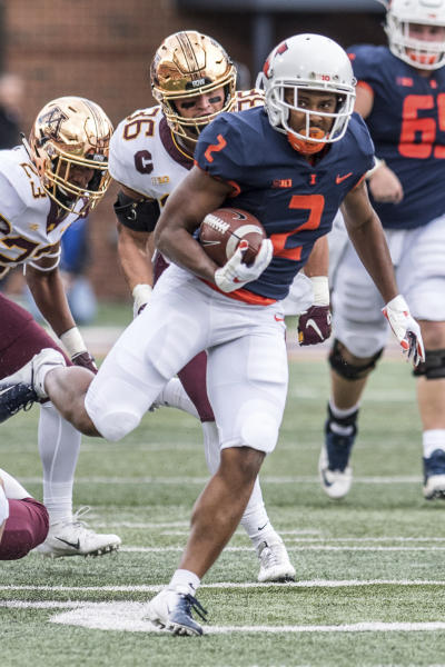 FILE - In this Nov. 3, 2018, file photo, Illinois running back Reggie Corbin (2) breaks a tackle to score Illinois' first touchdown of the game against Minnesota in the first half of an NCAA college football game in Champaign, Ill. Heading into the Year 4 of Lovie Smiths tenure, the Illini are still looking to reach bowl eligibility under the former Super Bowl coach. Corbin, a senior with blazing speed, broke out last season with 1,085 yards rushing on 8.5 yards per carry. (AP Photo/Holly Hart, File)
