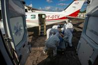 A Brazilian COVID-19 patient is moved on July 15, 2020 from a plane equipped as an ICU unit into an ambulance on the way to the Santarem Field Hospital, as the country's public health care system struggles to keep up with the coronavirus (AFP Photo/TARSO SARRAF)