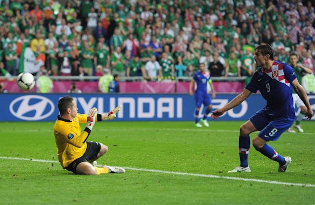 POZNAN, POLAND - JUNE 10: Nikica Jelavic of Croatia scores their second goal past Shay Given of Republic of Ireland during the UEFA EURO 2012 group C between Ireland and Croatia at The Municipal Stadium on June 10, 2012 in Poznan, Poland. (Photo by Jamie McDonald/Getty Images)