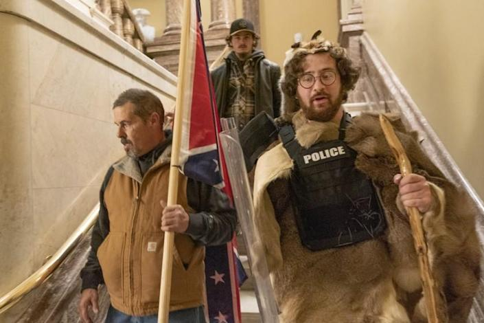 Supporters of President Donald Trump walk down the stairs outside the Senate Chamber as violence erupted at the Capitol after demonstrators breached the security and stormed the U.S. Capitol, Wednesday, Jan. 6, 2021 in Washington. (AP Photo/Manuel Balce Ceneta)
