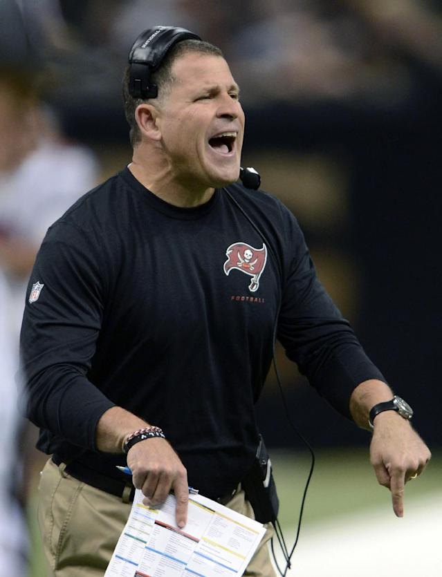 Tampa Bay Buccaneers head coach Greg Schiano reacts on the sideline in the first half of an NFL football game against the New Orleans Saints, Sunday, Dec. 29, 2013, in New Orleans. (AP Photo/Bill Feig)