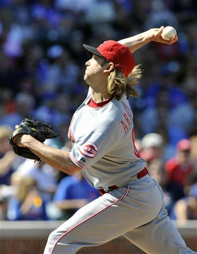 Cincinnati Reds' Bronson Arroyo pitches against the Chicago Cubs during the first inning of a baseball game Saturday, Aug. 11, 2012, in Chicago. (AP Photo/Jim Prisching)