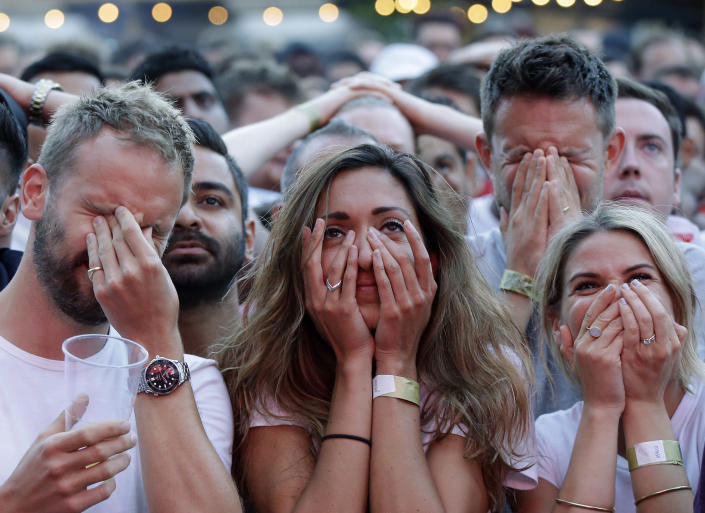 FILE - In this July 11, 2018 file photo England soccer fans react after Croatia scored their side's first goal as they watch a live broadcast on a big screen of the semifinal match between Croatia and England at the 2018 soccer World Cup, in Flat Iron Square, south London. (AP Photo/Luca Bruno, File)